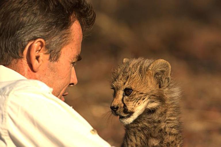 Kim Wolhuter with a cheetah cub.