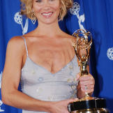 With her 2002 Emmy Award for Outstanding Guest Actress In A Comedy Series.