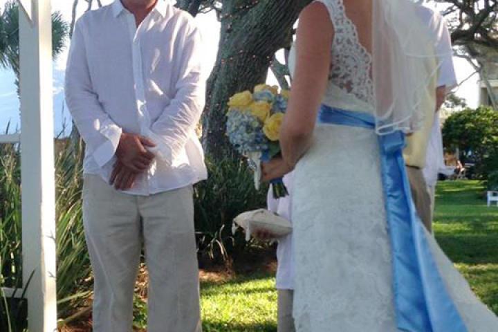 Around her waist, Ansley wears a custom hydrangea-blue sash.