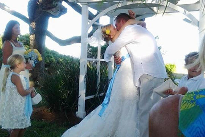 The couple shares their first kiss as husband and wife.