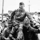 A Hero's Welcome. Colonel Robin Olds is hoisted and paraded on the shoulders of pilots of his 8th Tactical Fighter Wing after the successful completion of his 100th combat mission over North Vietnam.