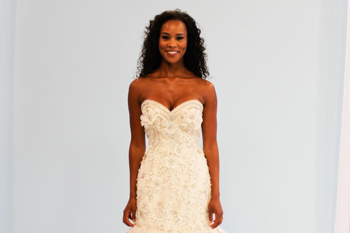 Amber-Joi was planning a high-energy, high-glam wedding in Philly and needed a Beyonce-worthy dress to match. This new gown, Ysa Makino's Petals, priced at $3,920, had drama to spare! The fit and flare silhouette had metallic thread, crystals and hand-placed organza flowers that all lent extra pop.