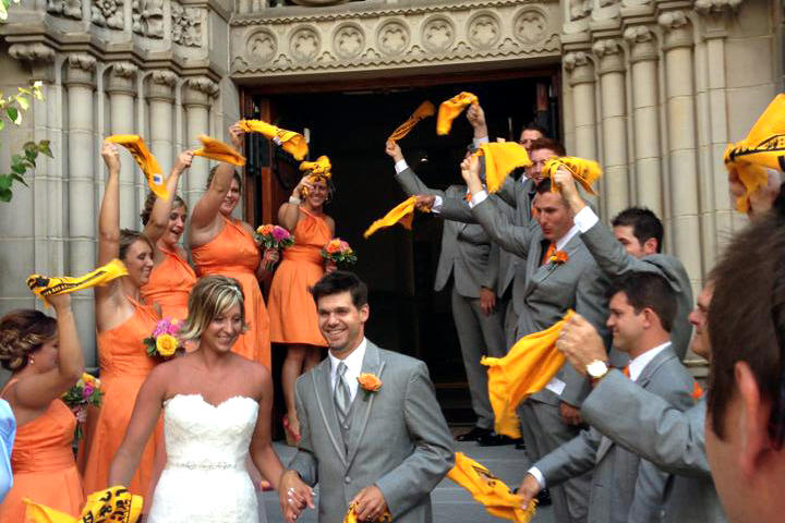 """After the ceremony, the guests stood outside the church waving """"terrible towels,"""" a Pittsburgh Steelers staple, for the bride and groom."""