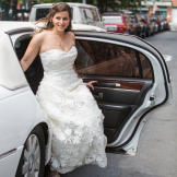 Andrea arrived via a white limousine for her wedding day!