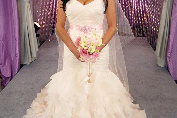 Light layers of pink organza are ultra feminine. This bride ties her look together with a bright pink sash and beaded accessories.