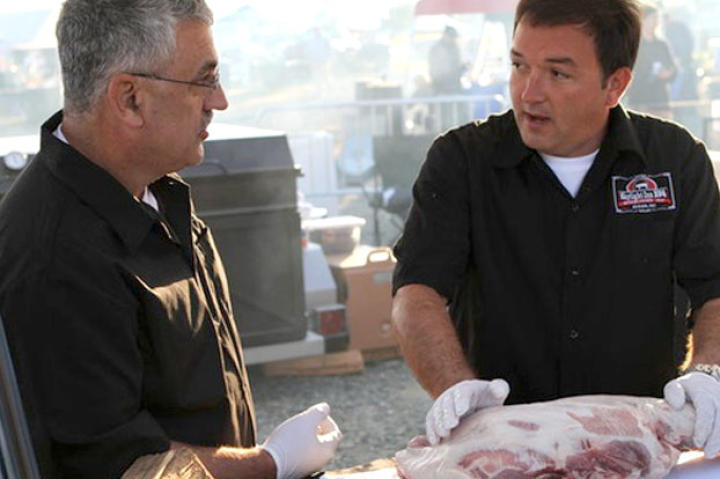 Sam Jones (right) of Skylight Inn BBQ Restaurant competes to see who is BBQ Pitmasters' North Carolina champion.