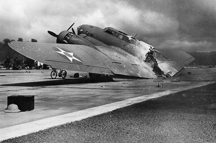 This B-17 was flying into Hickam Field, Oahu, Hawaii as the surprise attack on Pearl Harbor was underway. Hit during her approach, the plane fell apart as it landed, but the crew survived.