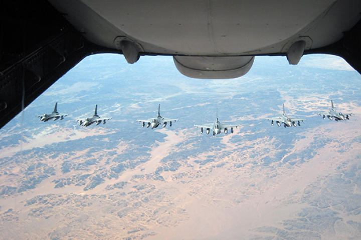 Six F-16 Fighting Falcons wait their turn to be administered fuel from a KC-10 over Afghanistan during Operation Enduring Freedom. In 2009, KC-10s from the 380th AEW and the 908th EARS flew 4,760 combat sorties offl-loading 422,222,300 pounds of fuel.