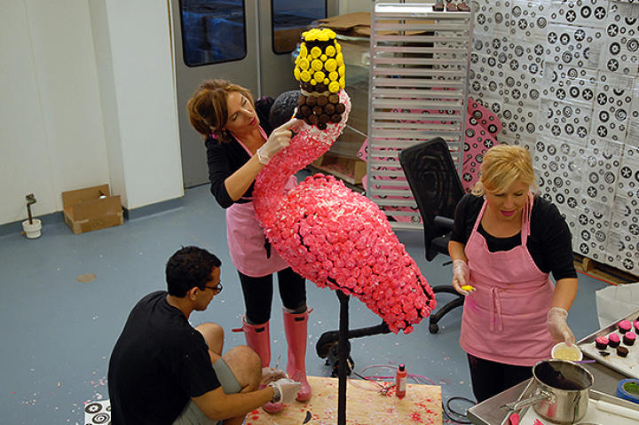 The HonFest flamingo is outfitted with pink coconut feathers and a bright yellow beehive.