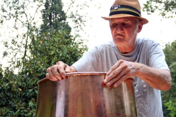 Jim Tom builds a traditional copper still.