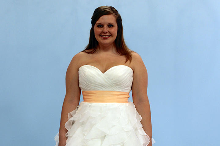 Audrey, a young bride from Indiana, had reservations about trying on bridal gowns -- she was worried her body wouldn't look good in them. So, she was pleasantly surprised when she saw her hourglass figure highlighted by fit and flare styles. Despite her family's opinion, Audrey chose this