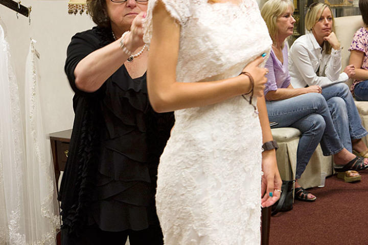 Mike's family takes Aziza shopping for a wedding dress.