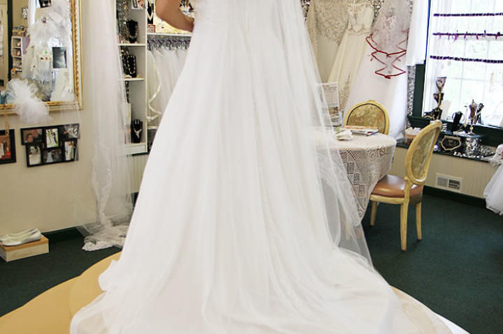 Aya enjoys a final moment in this gown and veil; she and Louis get frank about his financials, and it looks like this gown is out of the question. Their wedding planning takes a sad turn, and Aya is crushed that she won't be getting that dress.