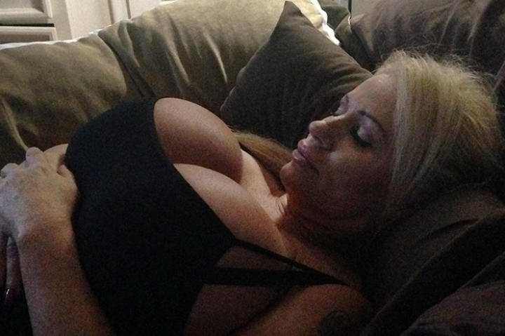 Lacey Wildd struggles to get a good night's sleep due to the weight of her breasts.