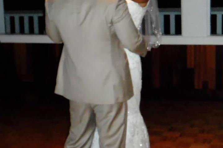 Karina beams on the dance floor at her wedding.