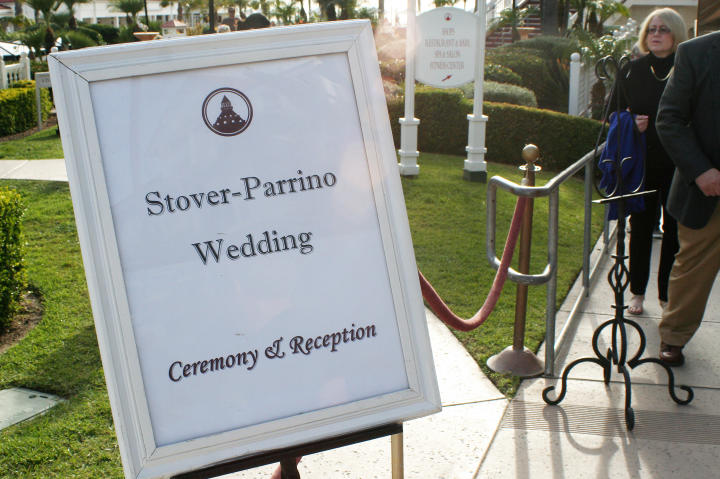 A sign welcomes guests as they arrive for the formal event.