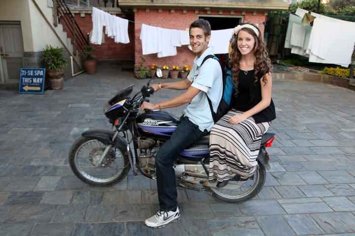 Derick gives Jill a lift on his motorbike.