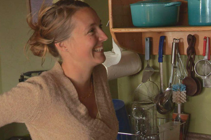 Eve smiles at Eivin after a successful first test of running water in their home.
