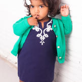 Zoey is way too cute in her navy blue tunic and bright green cardigan.