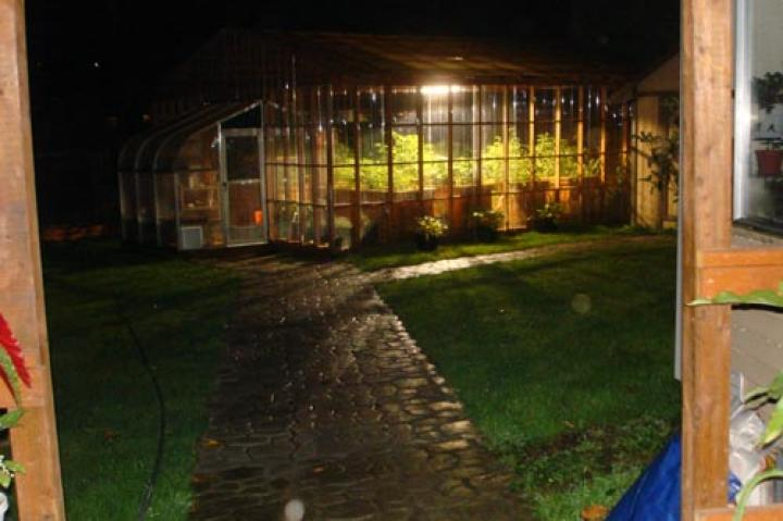 I have taken about a 100 pictures of our greenhouse, but only this one at night. It's also the only one that shows these spirits. The closest one I believe is my dad, he passed on 4/28/10, just two days before my wedding. The 2nd I believe to be my ex-husband (my daughter's dad) who killed himself on 8/2/10, when my daughter was 16. The 3rd one in the back, I believe is my grandfather,  who passed away in 1985, 2 days after my daughter turned 2 years old. The last time I was able to communicate with him was on her birthday. I showed him her last picture and told him that it was her birthday. He couldn't talk but he squeezed my hand and let me know he was happy to hear it. From the day of my grandpa's passing, I have always felt that he has kept a watch over Susie and me. But I believe now he is standing back to let the others come forward.  -- Cheryl S.