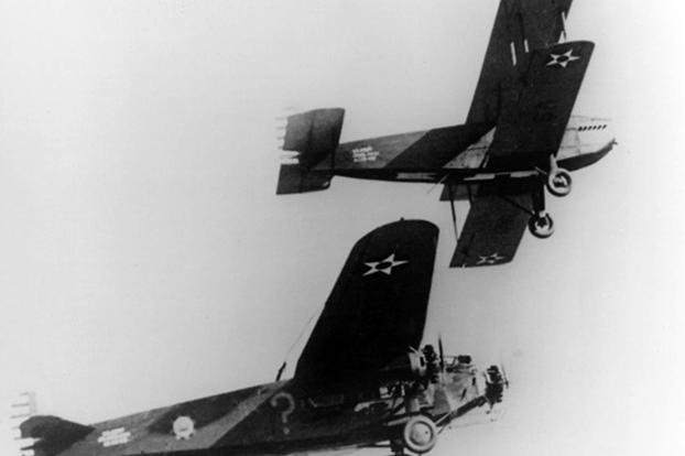 A closer view of the Fokker getting refueled by the Douglas C-1.