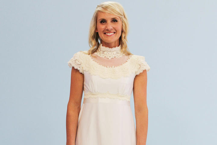 Marcy's other dress choice was this lace and chiffon A-line from her mother's closet. While her mother was proud that the gown once graced the cover of a bridal magazine, Marcy was unimpressed with the satin belt, high neckline and cap sleeves.