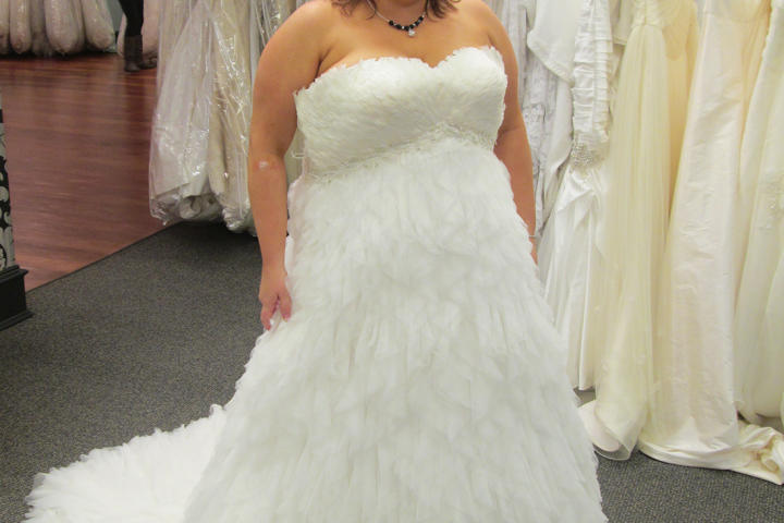 "Becky was shopping for ""a really cool and different dress"" for her vow renewal ceremony. Even though half her entourage scoffed at this ""chicken"" dress, Becky thought the feathers were really cool and chose it for her event. The Pronovias design retailed for $2,600, but Becky paid just $1,300 at Vows."