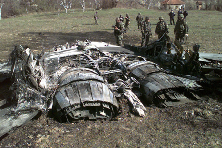 One MIG mess. A U.S. Army documentation team surveys the wreckage of a Former Republic of Yugoslavia MiG-29 Fulcrum jet fighter shot down by NATO forces in Bosnia and Herzegovina, March 27, 1999.