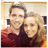 The couple poses for a photo using a favorite Duggar pose --