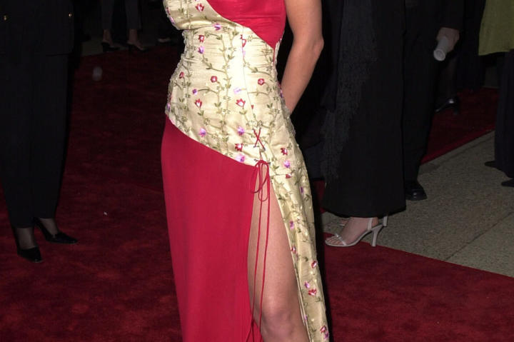 Leah stuns in a glamorous red dress at the 27th Annual People's Choice Awards in January 2001.