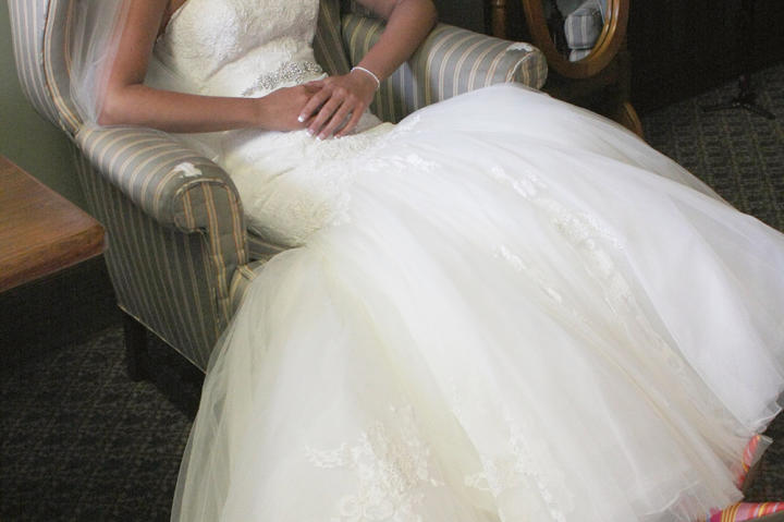 But first the bride gears up for a church ceremony. Laura Ann lounges in her beautiful wedding dress.