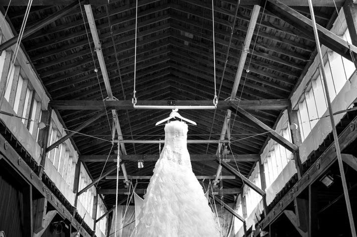 Kari's wedding was anything but traditional. Kari and her husband own a trapeze studio and thought it would be fitting for the day to revolve around their shared love of trapeze and entertainment. Here, Kari's dress hung from the trapeze bar.