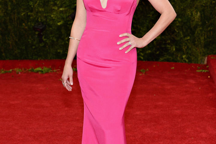 Actress Reese Witherspoon made jaws drop in this hot pink dress Stella McCartney gown. Notice the unique and ultra-flattering neckline.