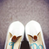 Jenn adds some jeweled details to her wedding shoes.