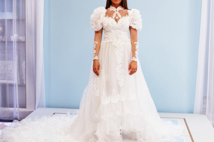 Alysha and Jen both considered wearing their mother's 1980s ruffled satin gown with puff sleeves and beaded appliques. While Jen felt a sentimental attachment to the bright white gown, Alysha (pictured) thought it should be hers to wear as the oldest daughter.