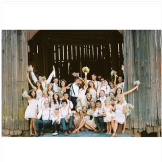 The entire bridal party -- 12 bridesmaids and 11 groomsmen -- show the
