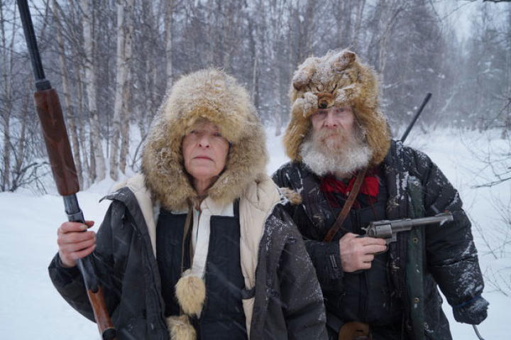 Jim and Nancy pose with their guns. The couple lives completely off the grid and relies on the Alaskan Railroad to bring them life-sustaining supplies.