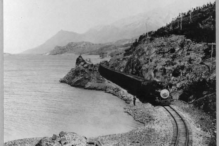 White Pass Railway train on the shores of Bennett Lake, near the Alaskan port of Skagway.
