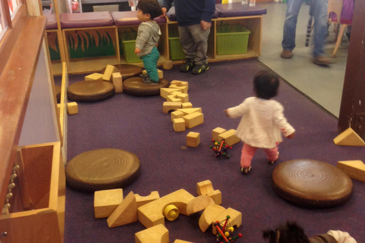Bill tries to wrangle the kids while they play at the Bay Area Children's Museum.