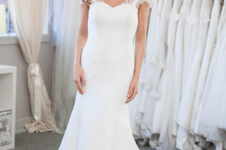 Ashley gets a feel for this trumpet silhouette. The lace cap sleeves are incredibly feminine.
