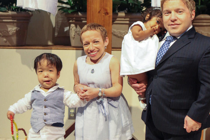 """Bill and Jen are all smiles with Will and Zoey after their baptism. About their Catholic faith, Jen says, """"It's an important part of who we are."""" The proud parents gave their children crosses the morning of their baptism."""