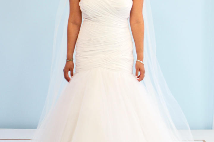 Susan couldn't believe how sexy her mother's dress was! She loved the halter neckline and flirty tulle skirt. It cost only $880 to make these updates, and Susan gladly agreed to wear this dress down the aisle.