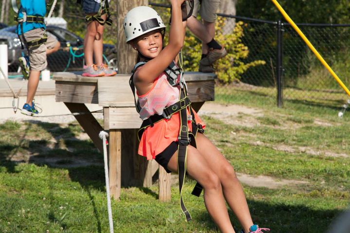 Hannah tries her hand on the ropes course.