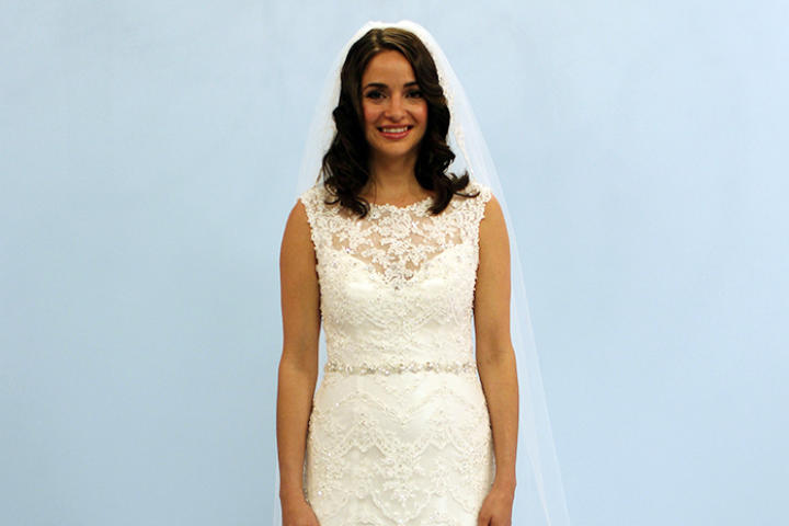 New York bride Dr. Erika surprised her Italian-Irish family by planning an outdoor wedding with no bridal party. While she had the option of wearing her mother's 1970s gown, Erika was enchanted by this