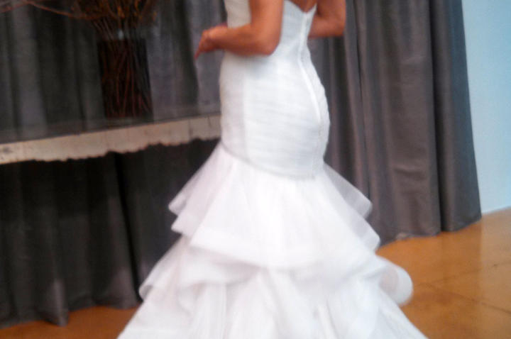 """""""Brides will always want this kind of shape and this dramatic skirt,"""" Monte says, """"but Judd Waddell has really improved the design."""" Note the seam between bodice and skirt. It's angled to cup the butt, offering heightened sex appeal and creating greater ease of movement."""
