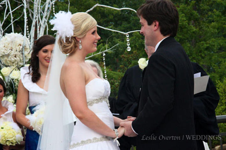 """Holly and her groom, Robert, exchange vows during the ceremony. """"We were so excited to be getting married,"""" Holly says. """"All we could do was look at each other and smile."""""""