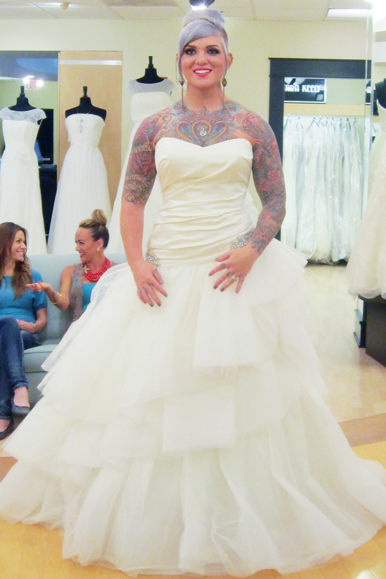 Pictures of wedding dresses that show off your ink tlc for Wedding dress in atlanta
