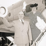 first-lady-fashion Harry and Bess Truman Wave from Plane Ramp