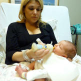 Mommy time!  Lisa gives baby Carlo one of his first bottles.