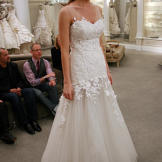 Jackie looked ethereal in this lace A-line gown with floral appliques.